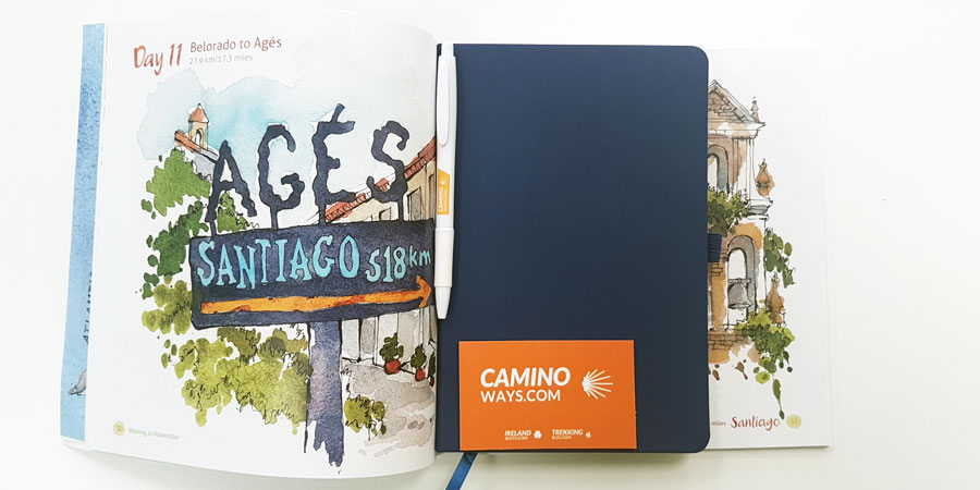 Example of a Camino diary next to 'Walking in Watercolor' by Jennifer Lawson
