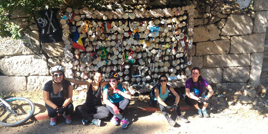 scallop-shell-wall-with-team-cycling-the-camino-portugues-caminoways